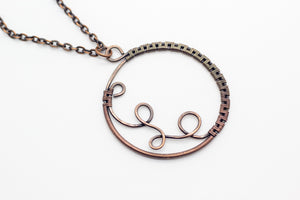 Handmade circular copper wire wrapped pendant