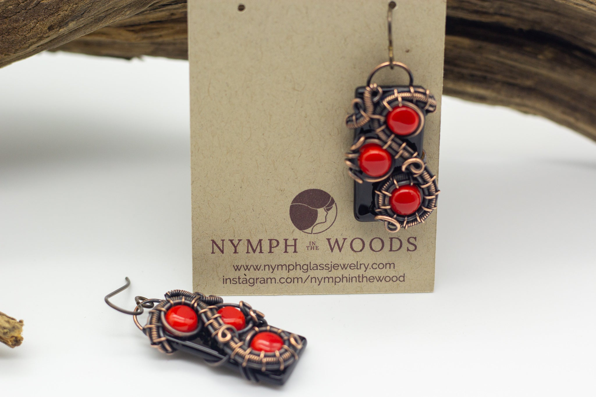 Handmade earring with red and black fused glass and copper wire wrapping