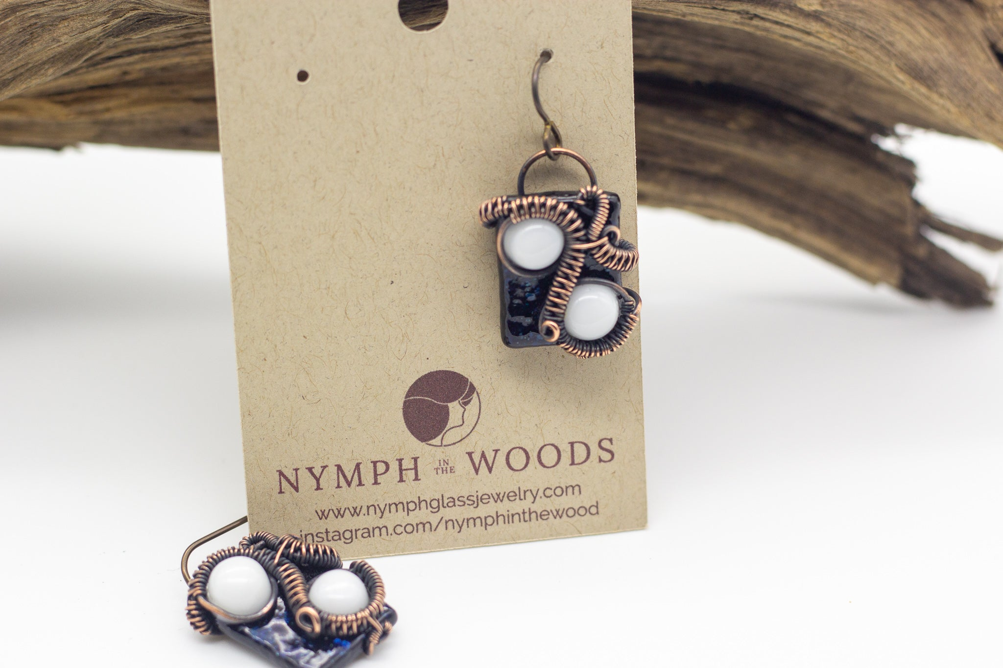 handmade white and dark blue fused glass earrings with copper wire wrapping from Nymph in the Woods