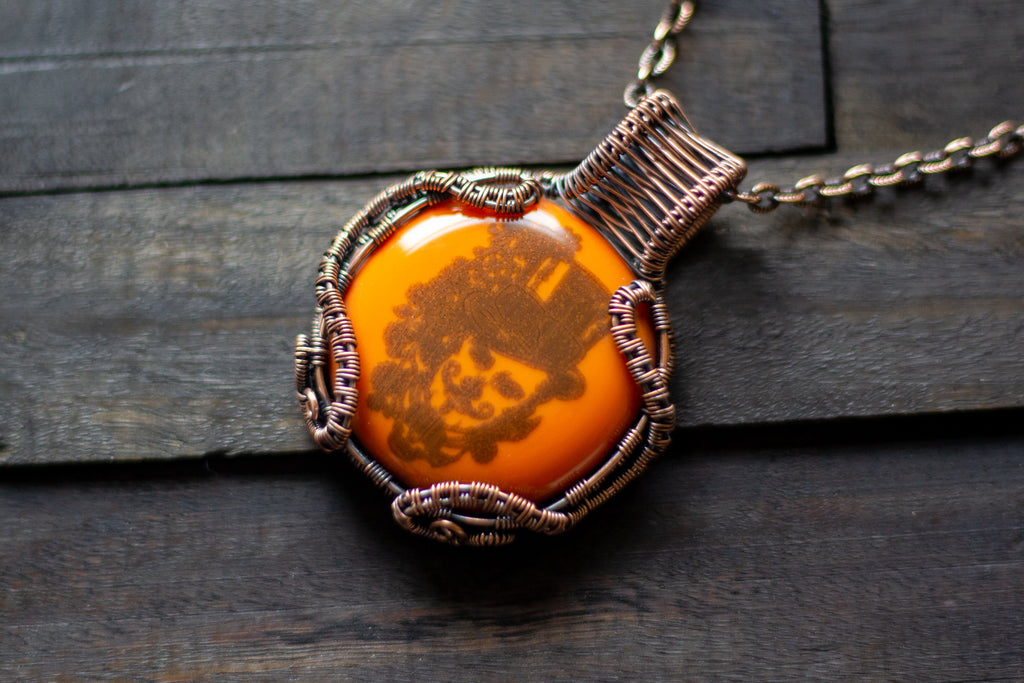 Copper Wire Wrapped Pendant with Steampunk Man on Orange Fused Glass