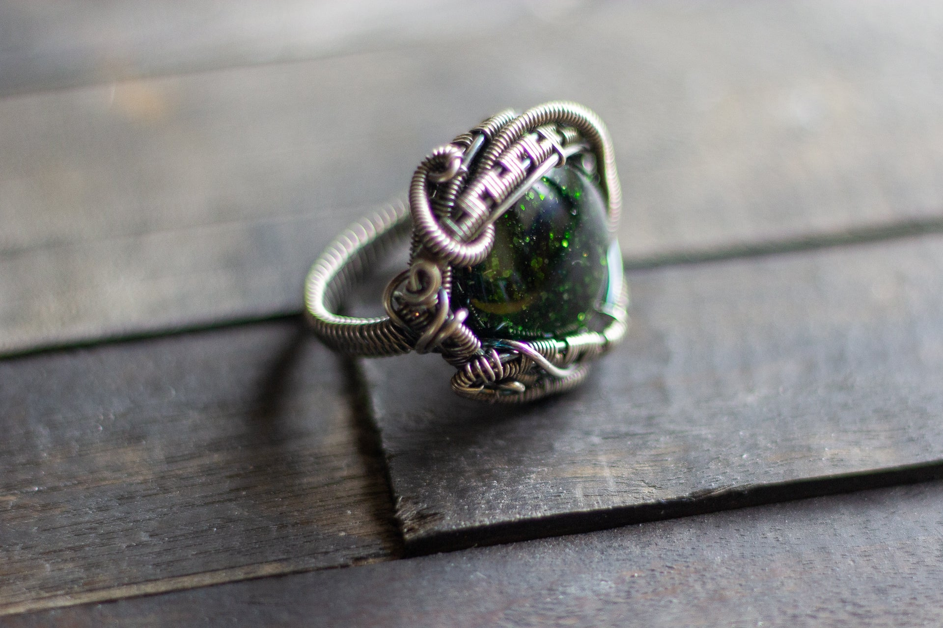 sterling silver statement ring with glittery green dichroic fused glass