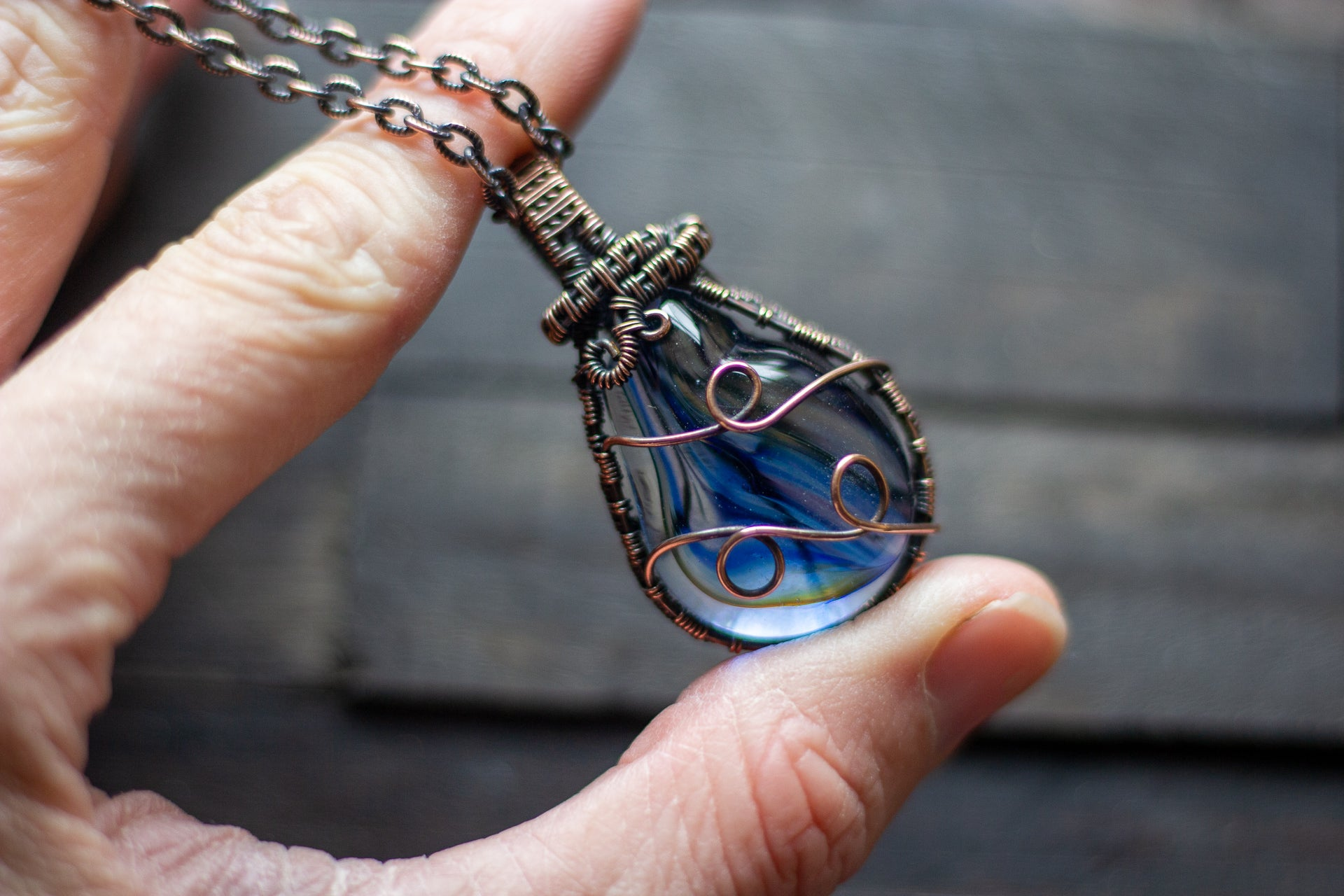 Transparent Streaked Blue Fused Glass Pendant with Copper Wire Wrapping
