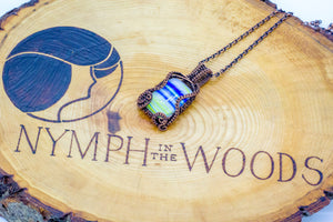 Yellow-blue-white-streaked-fused-glass-copper-wire-wrapped-pendant-nymph-in-the-woods