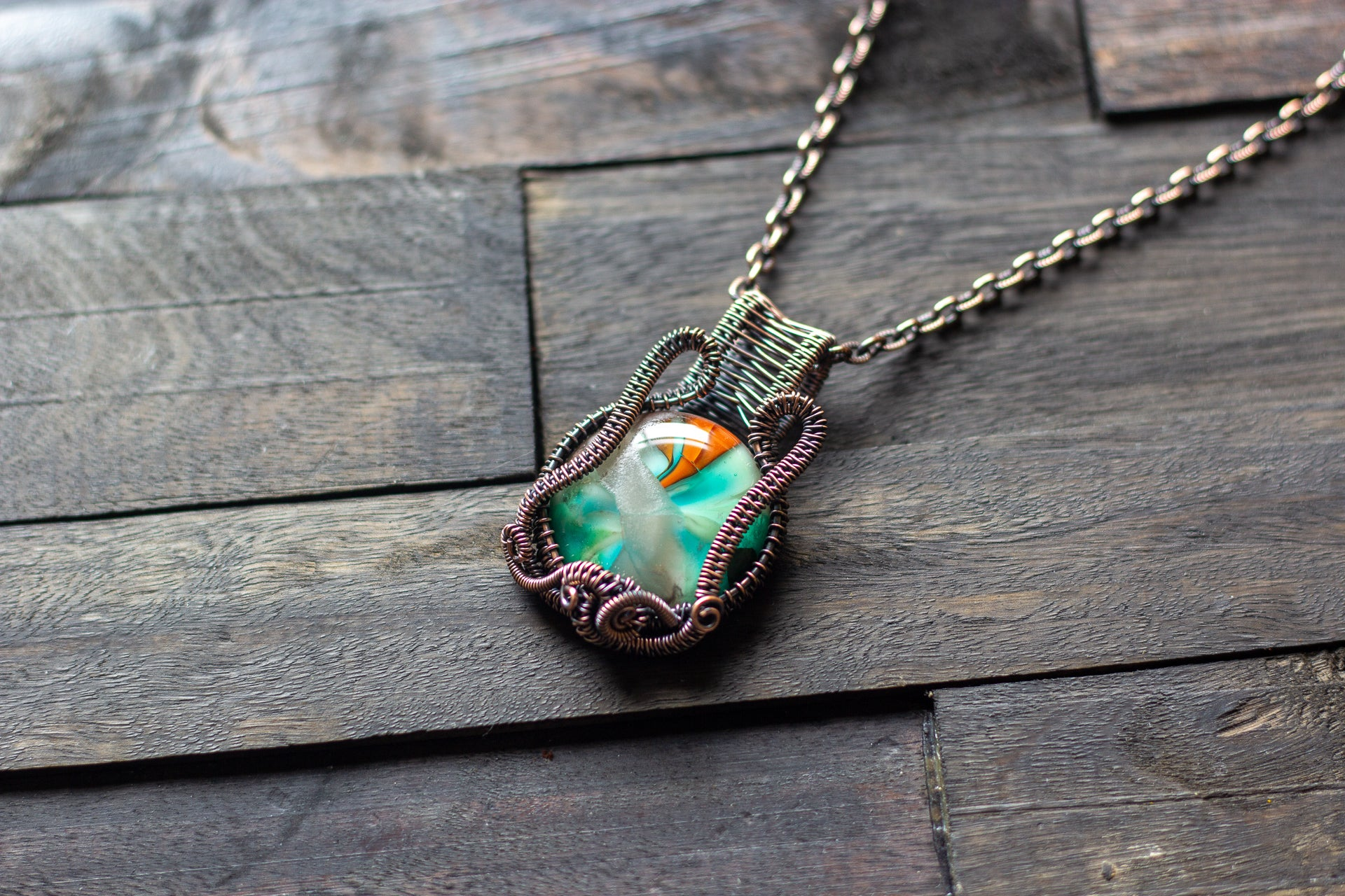 Copper Wire Wrapped Pendant with Blue-green and Orange Glass