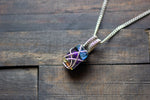 Dichroic Blue, Purple, and Gold Crisscross Sterling Silver Wire Wrapped Pendant