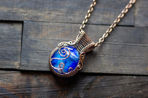 Swirls of Blue Fused Glass and Copper Wire Pendant