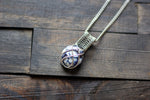 Silver, Blue, and White Crisscross Sterling Silver Wire Wrapped Pendant