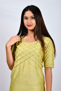 Byogi Soumya collection.This is the closeup of green Barfi embroidered kurtis latest design in the festive wear for women.