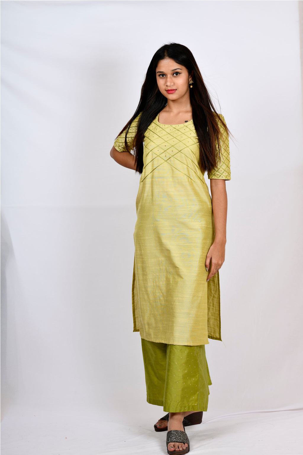 Byogi Soumya collection.This is the green Barfi embroidered kurtis latest design in the festive wear for women.