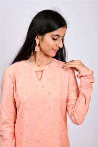 Byogi Soumya collection. This is a closeup of Churi sleeves kurti which is a festive women wear.