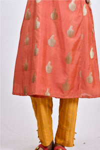 It is an Angarakha kurti for women with pants. This is a festive kurti for women.