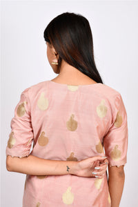 Byogi Soumya collection. This is a back view of Jacquard kurti for women.  It comes under the Festive kurtas for women pink category. It is a kurti palazzo set for women with dupatta.