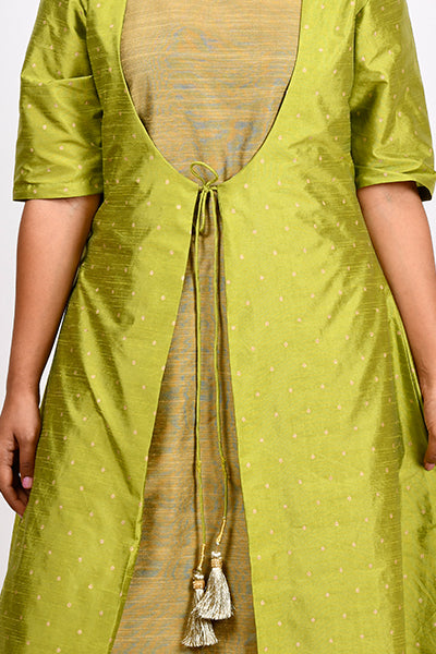 Byogi Soumya collection. This is a closeup of green double layered kurti for women. It has a Cotton a line kurta for women and a sleeveless jacket.