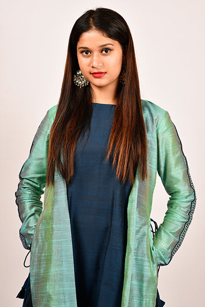 Byogi Soumya collection. This is a line kurtas for women. It comes under the Festive kurtas for women blue category. It contains Sleeveless A-line Kurti layered with an embroidered, straight-cut full sleeves jacket.