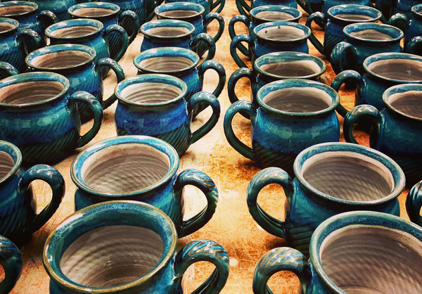 Freshly fired Harris mugs from Rupert's workshop kiln.