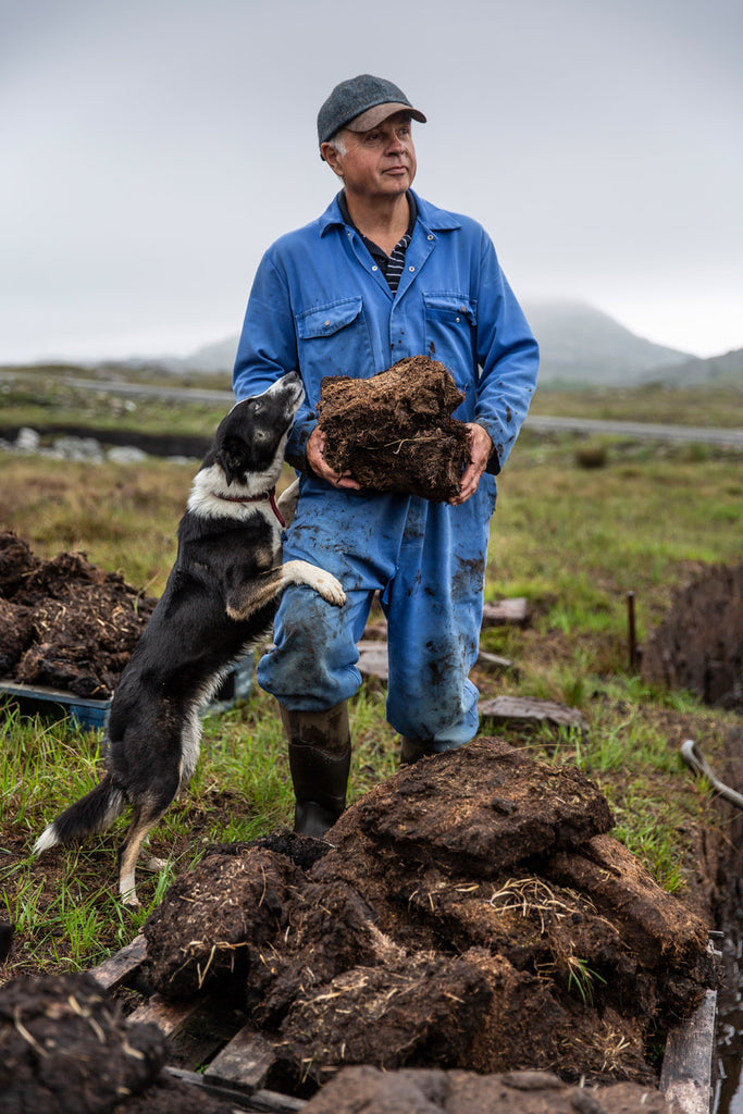 Bill Cross (and friend) at the peats, soon to be fully dried and brought home.