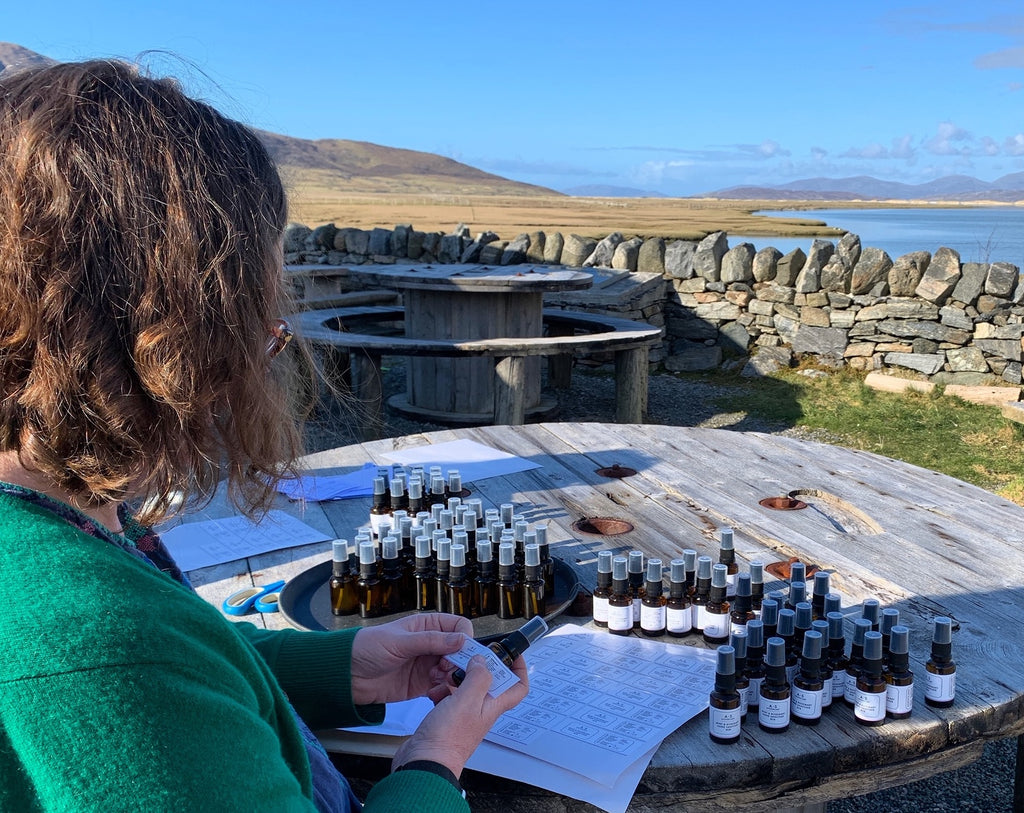 Amanda labelling her bottles in the village of Northton, south Harris.