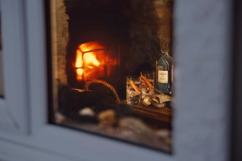 A blaze burning in a Harris hearth, with warmth awaiting inside.
