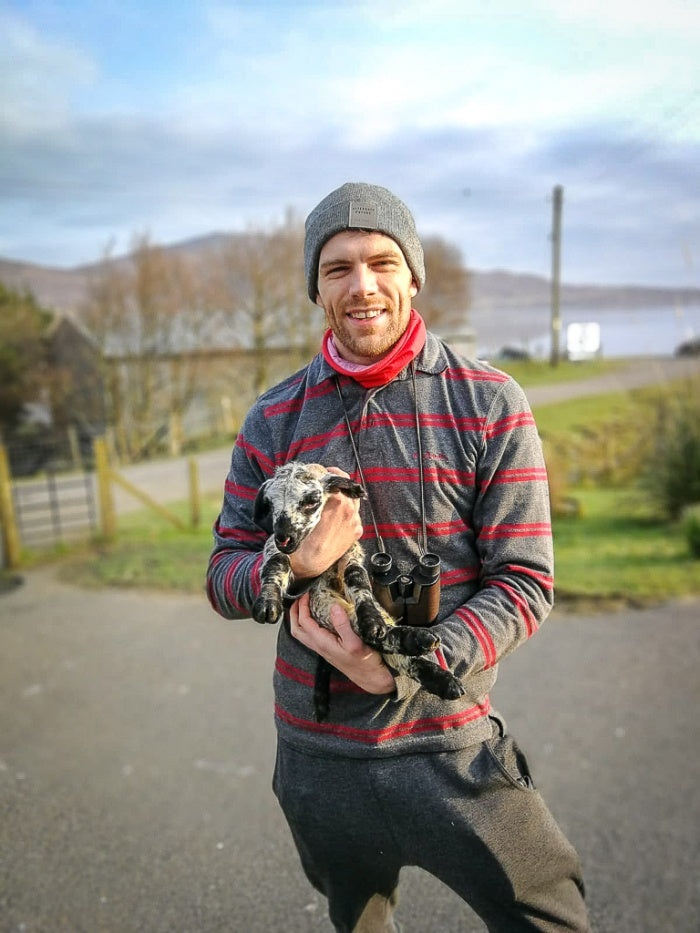 Chris Thomson getting hands-on with the lambing season.