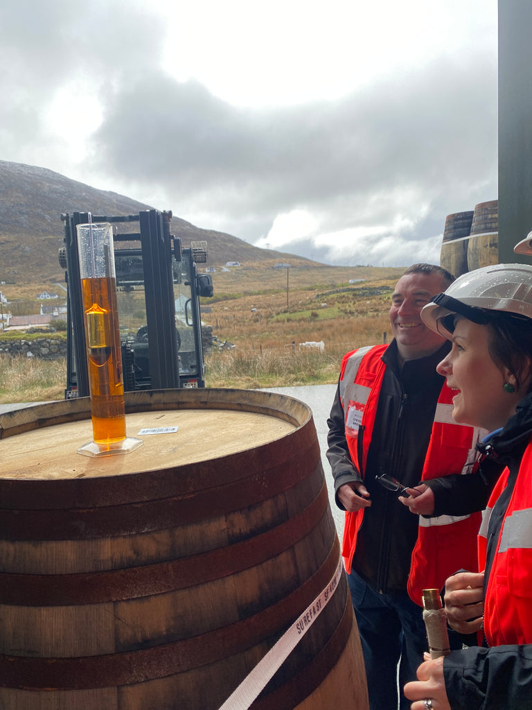 Shona at our Ardhasaig warehouse taking samples from our casks.