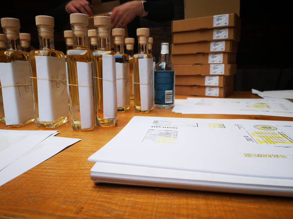 Hand-written labels, each signed by the Head Distiller...