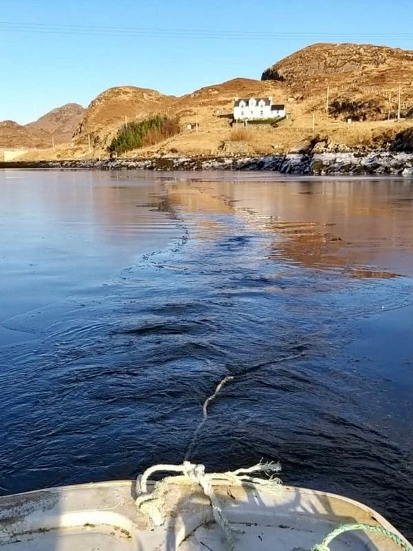 Local fishing boat, the 'Lead Us', breaks through the thawing ice at Stockinish. Image  © Marie M Morrison.