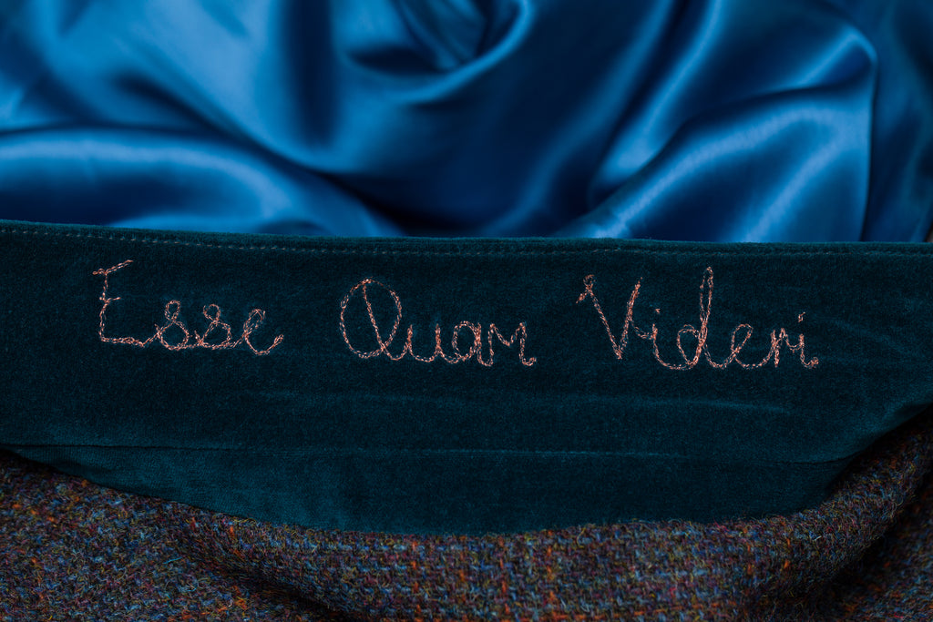Our distillery motto, discreetly embroidered in rose gold thread.
