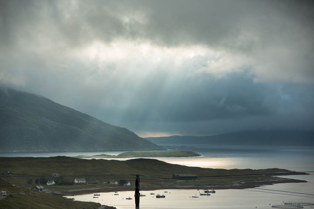 Sun rays as we look over to the cask warehouses at Ardhasaig