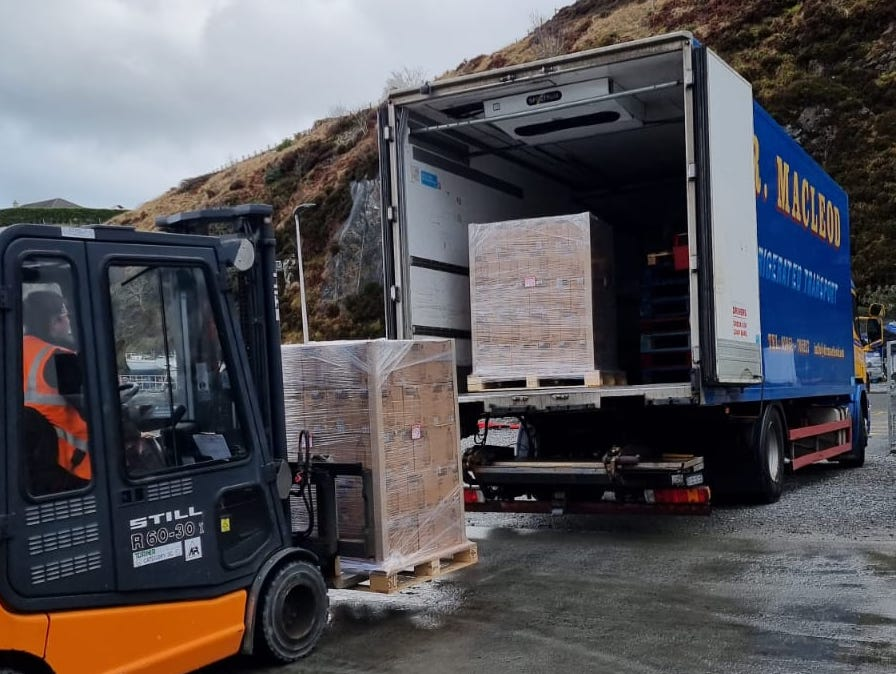 Pallets of Isle of Harris Gin are readied for the road in Tarbert...