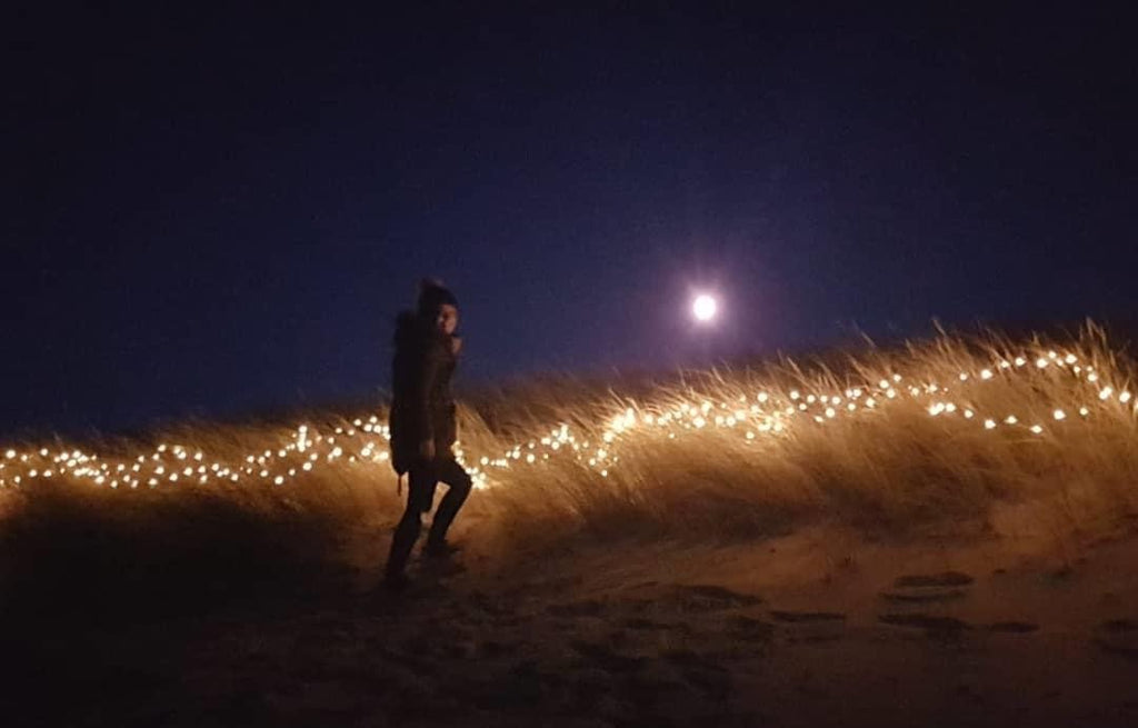 Late night fairylights and marram grass.