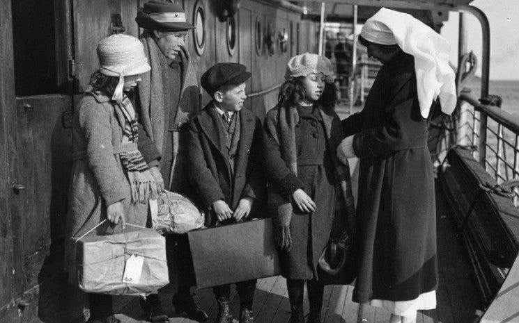 A nurse inspecting children from the Outer Hebrides on board the Canadian Pacific ship the SS Marloch, April 1924. © Getty Images