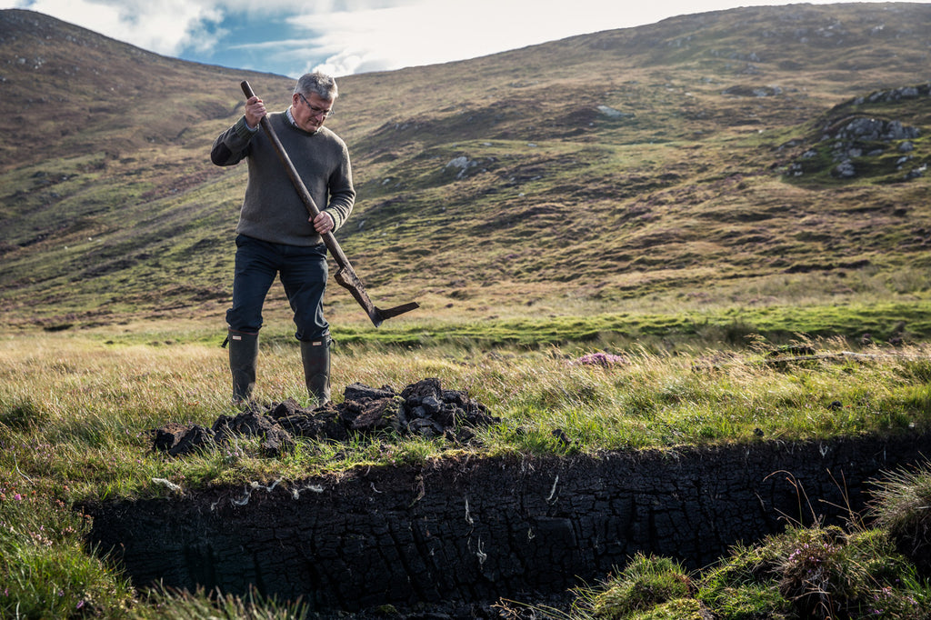 Head Distiller Kenny Maclean at the peat bank, South Harris.