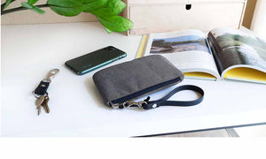 heather grey organize zip pouch, canvas clutch with black wrist strap, fits iPhone and small accessories