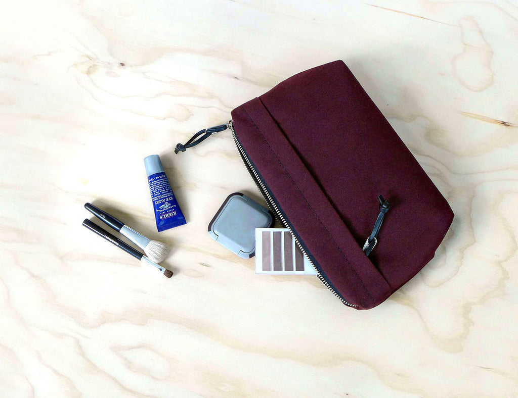 waxed canvas dopp kit in plum, makeup bag