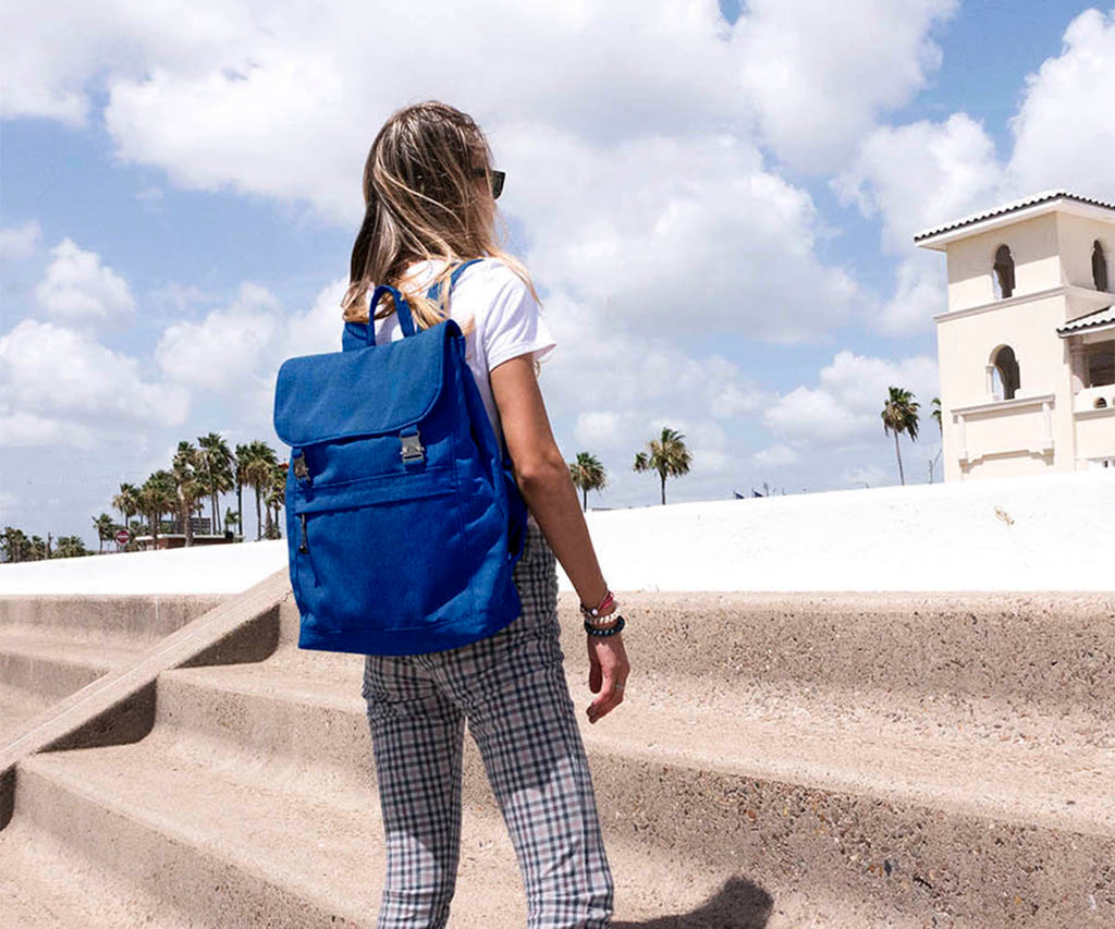 canvas travel backpack, royal blue, palm trees by the beach
