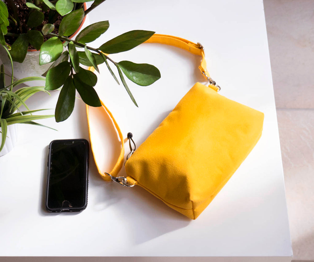 waxed canvas fanny pack in yellow, small clutch