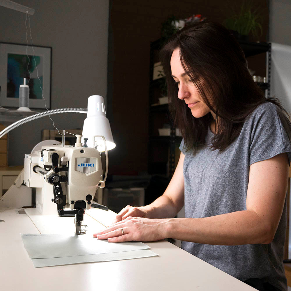 designer and maker of stanfield canvas bags, sewing process