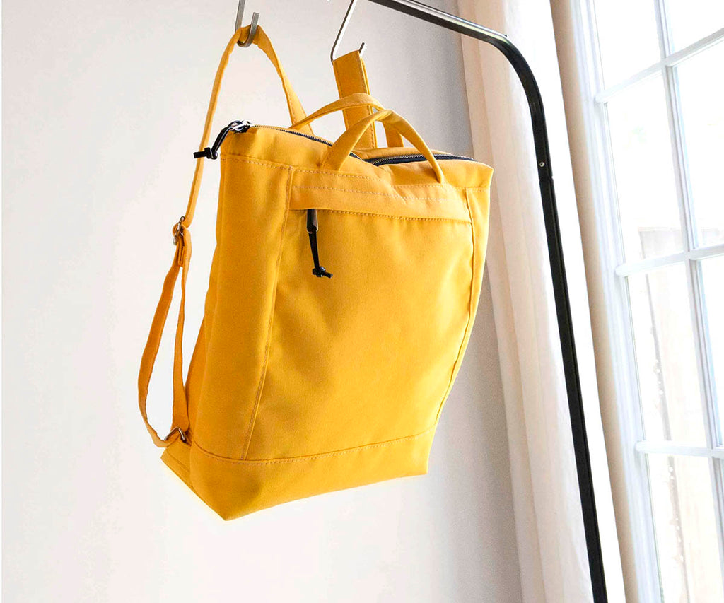 zip backpack in yellow waxed canvas