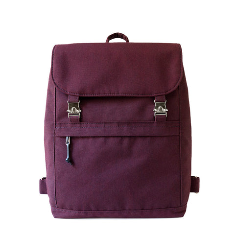 minimalist canvas backpack in plum with buckle closure