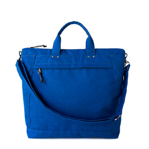simple tote bag with short handles and long shoulder strap in royal blue