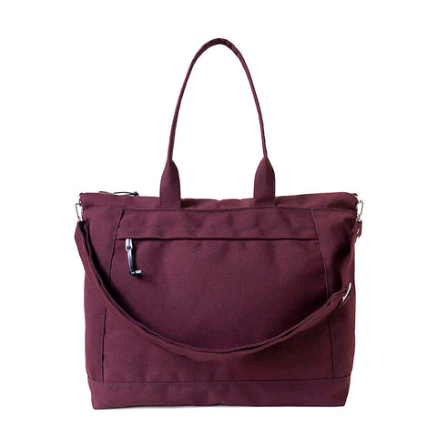 large waterproof canvas tote with outside zipper pocket and removable shoulder strap in plum