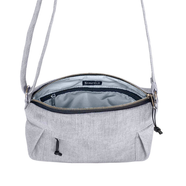 small canvas cross body bag in light gray interior pockets