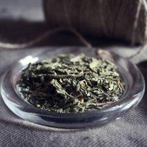 a dish of green Earl Grey decaffeinated loose leaf tea