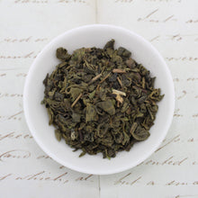 Load image into Gallery viewer, View from above of green tea with mint