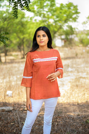 Mangalagiri tunic with lace detail in a shade of papaya orange - EARTHICA
