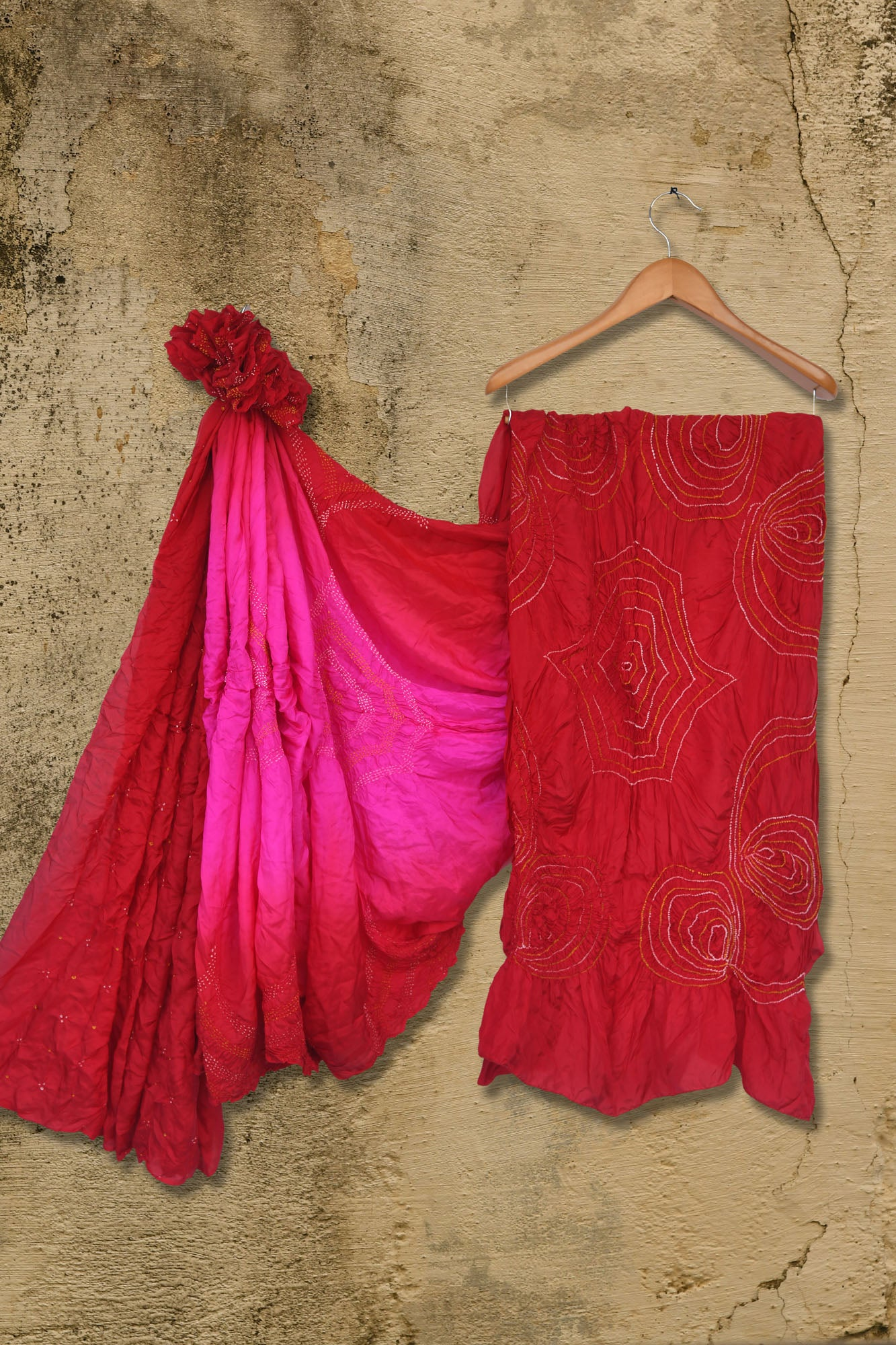 Hot pink bandhani silk saree with red border - EARTHICA