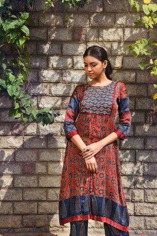 Barn red ajrakh printed modal flared kurta with embroidered yoke. - EARTHICA