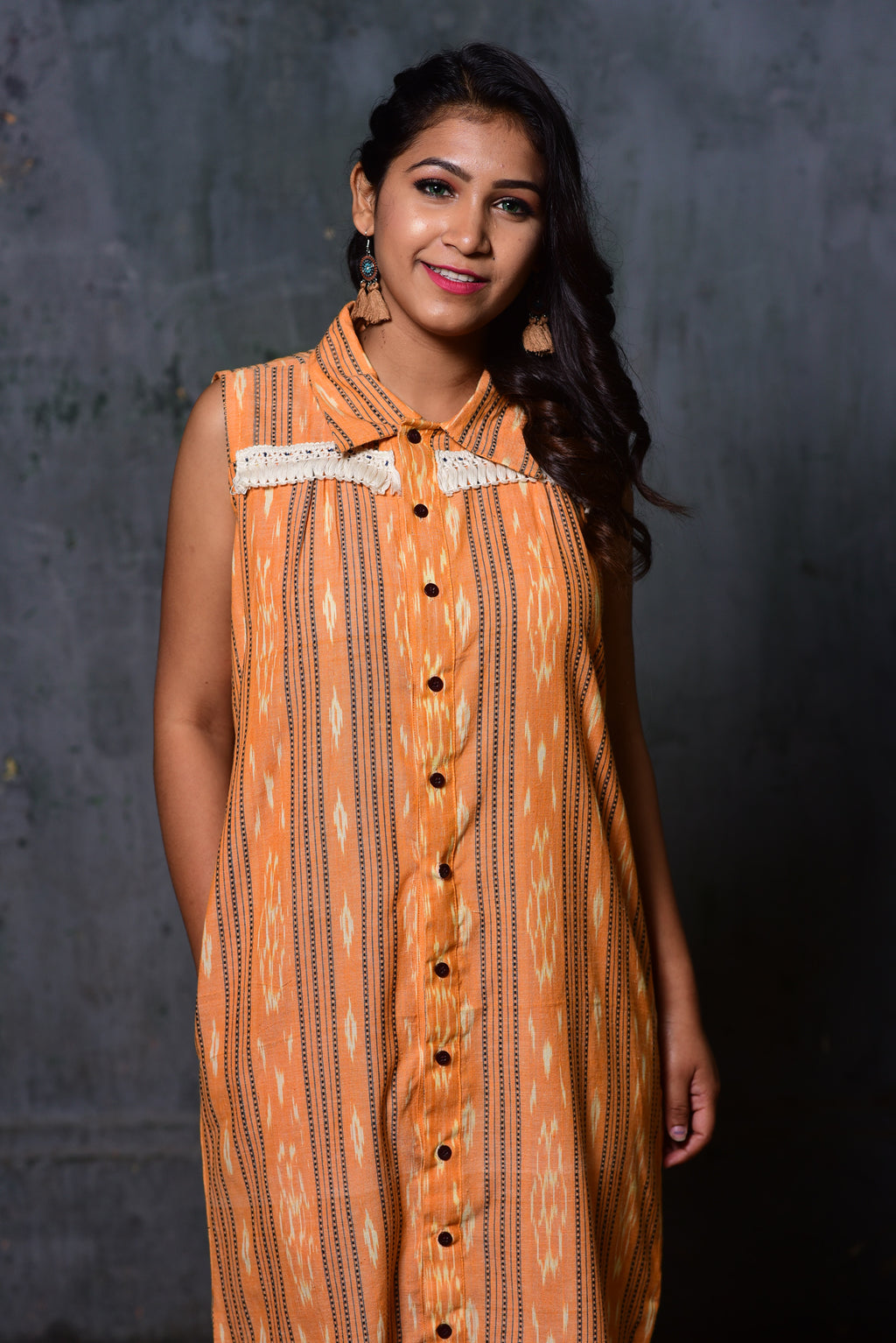 Apricot yellow ikat sleevelss shirt dress with lace detail and shirt collar
