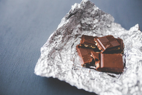 Chocolate bar with nuts in a foil wrapper