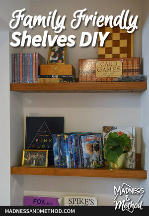 Here's a fun little project that solved a few issues for us over at our rental home.  I was looking to 1) find a designated spot for books, 2) display some games and DVDs for renters, and 3) fancy up a little alcove we had in our basement...